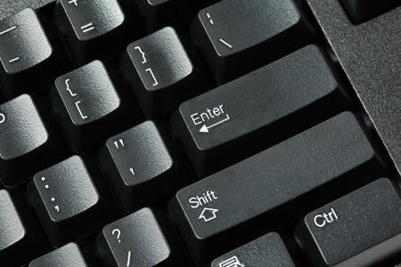 Black computer keyboard isolated on white background photo