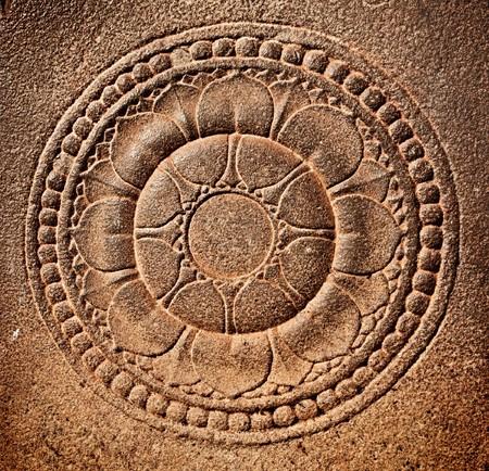 Stylized lotus carved on stone photo