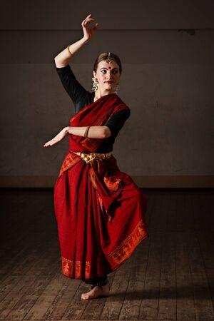 indian classical dance: Young woman in sari dancing classical traditional indian dance Bharat Natyam