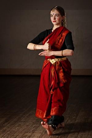 bharatanatyam dance: Young woman in sary dancing classical traditional indian dance Bharat Natyam