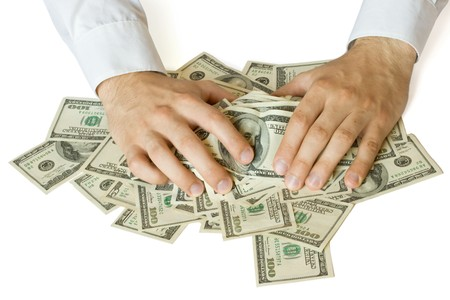 stingy: Greedy hands grabbing heap of money US dollars Stock Photo