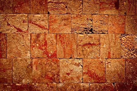 Texture of stone wall of ancient Mayan ruins in Mexico Фото со стока
