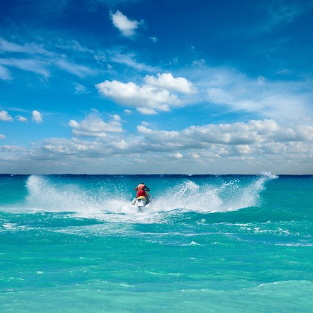 water jet: Man riding jet ski in Caribbean sea