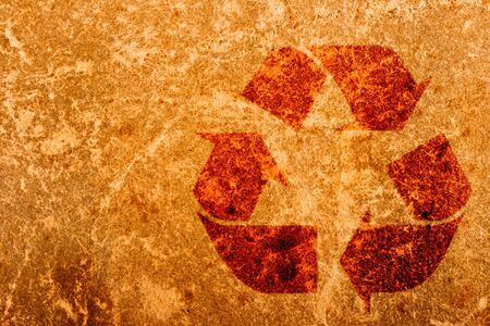 Recycling symbol on old paper texture close up  photo