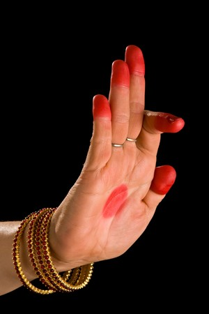 Woman hand showing Arala hasta (meaning bent) of indian classic dance Bharata Natyam photo