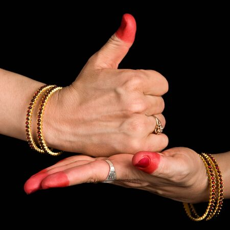 Woman hands showing Shivalinga hasta of indian classic dance Bharata Natyam photo