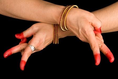 Woman hand showing Kartariswatika hasta of indian classic dance Bharata Natyam photo