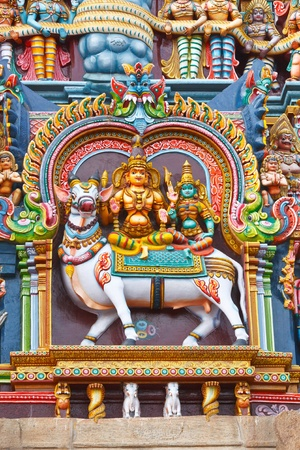 asian indian: Shiva and Parvati images. Sculptures on Hindu temple gopura (tower). Menakshi Temple, Madurai, Tamil Nadu, India