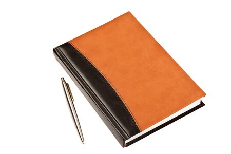 Diary with leather cover and metal pen on table isolated on white background photo