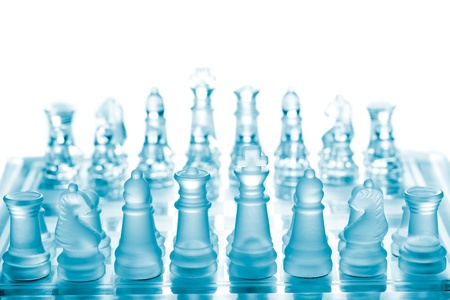 Glass chess on chessboard photo