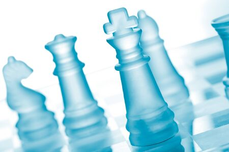bishop chess piece: Glass chess on chess board