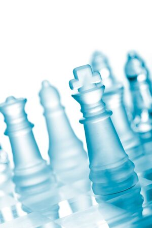 Glass chess on chess board Stock Photo - 9091689