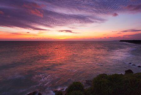 Ocean sunset on rocky coast. Varkala, Kerala, India photo