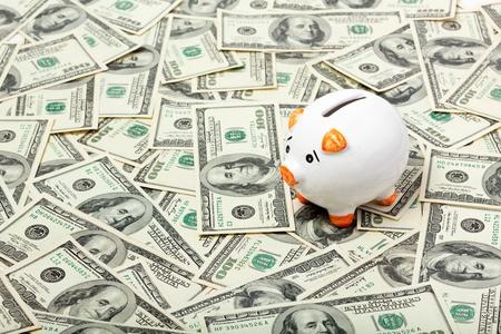 Piggy bank on dollars background photo