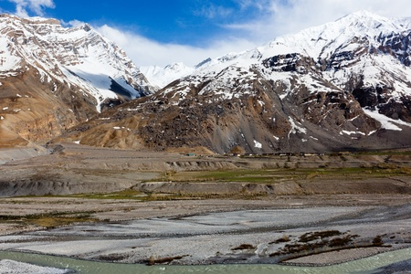 horizontals: Spiti Valley - village and snowcapped Himalayan Mountains. Himachal Pradesh, India