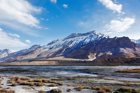 Spiti Valley -  snowcapped Himalayan Mountains. Himachal Pradesh, India photo