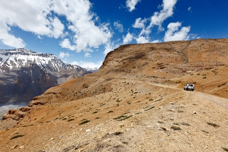 earthroad: Road in mountains (Himalayas) with car. Spiti Valley,  Himachal Pradesh, India Stock Photo