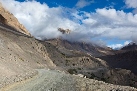 unsurfaced road: Road in mountains (Himalayas). Spiti Valley, Himachal Pradesh, India