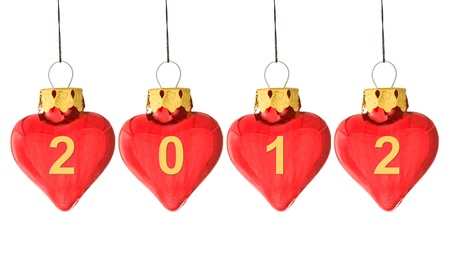Year 2012 is coming concept - 2012 written on several heart shaped christmas bauble isolated on white photo