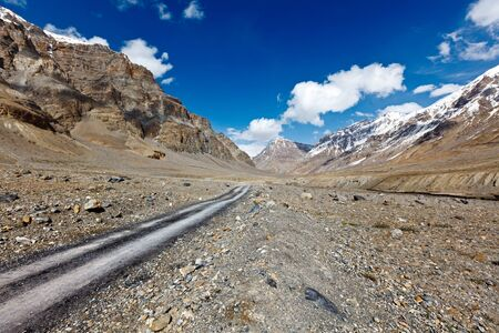 unsurfaced road: Road in mountains (Himalayas). Spiti Valley,  Himachal Pradesh, India Stock Photo