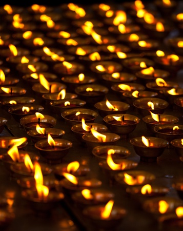 himachal pradesh: Burning candles in Buddhist temple. Tsuglagkhang complex,  McLeod Ganj, Himachal Pradesh, India Stock Photo