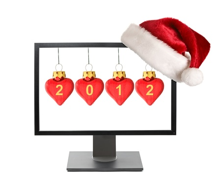 Cristmas online shopping concept - Computer monitor with Santa hat isolated on white background photo
