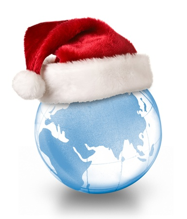 Christmas planet concept - Santa hat on crystal glass globe isolated on white background photo