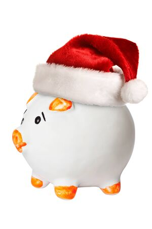 Piggy bank in Santa hat photo