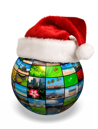 christmas concept: Christmas concept - photo globe in Santa hat Stock Photo