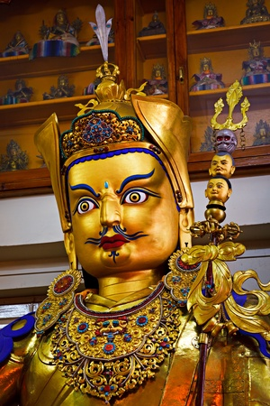 Gilded statue of Guru Padmasambhava in Tsuglagkhang temple. McLeod Ganj, Himachal Pradesh, India photo