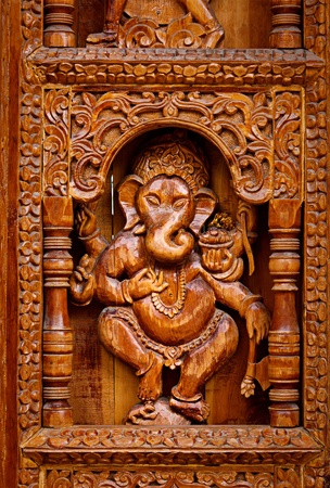 hand carved: Ganesh - wood caring in Hinde temple in Himachal Pradesh, India