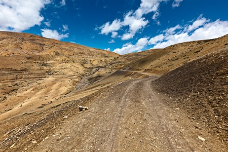 earthroad: Dirt road in mountains (Himalayas). Spiti Valley,  Himachal Pradesh, India Stock Photo
