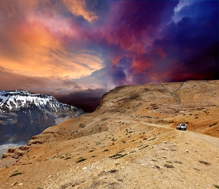 unsurfaced road: Road in mountains (Himalayas) with car. Spiti Valley,  Himachal Pradesh, India Stock Photo