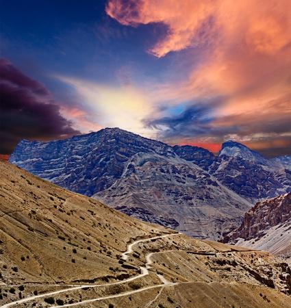 pradesh: Road in mountains (Himalayas). Spiti Valley,  Himachal Pradesh, India Stock Photo