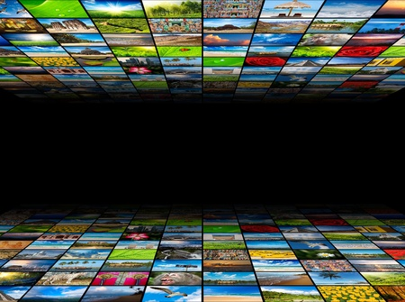 Abstract multimedia background composed of many images with copyspace in the center photo