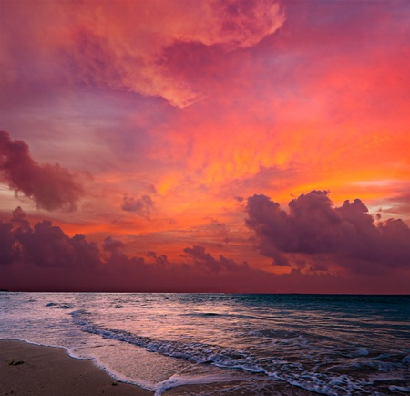 bali: Calm peaceful ocean and beach on tropical sunrise. Bali, Indonesia Stock Photo