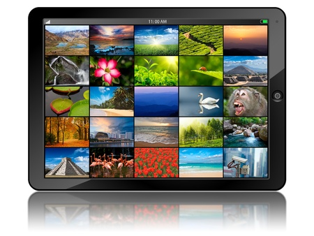 Tablet PC with photos Stock Photo - 12635674