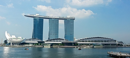 SINGAPORE - MAY 6: The Marina Bay Sands complex on May 6, 2011 in Singapore. Marina Bay Sands is an integrated resort and billed as the worlds most expensive standalone casino property. Panorama image