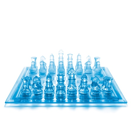 Glass chess on chess board photo