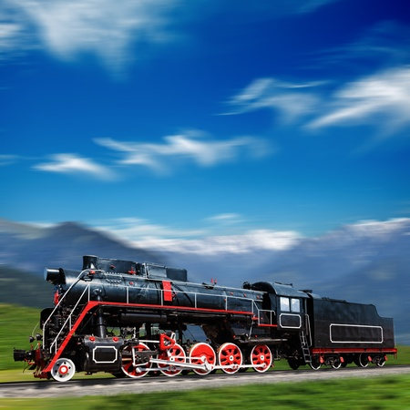 Speeding old locomotive in mountains photo