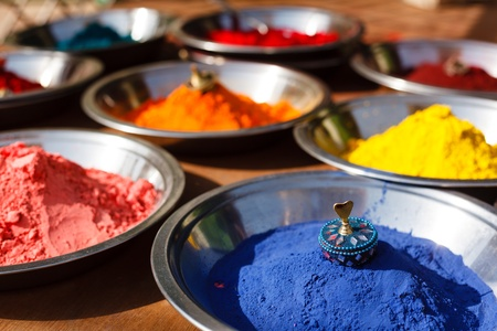 colored powder: Colored colorful powder kumkum on Indian bazaar for holi festival celebration Stock Photo