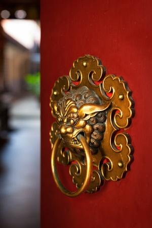 Doorknob of the Temple shaped as a jiaotu (dragon). Shuang Lin Temple, Singapore photo