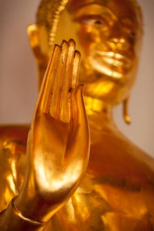 Buddha golden statue blessing hand photo