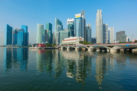 Singapore business district skyscrapers and Marina Bay in day photo