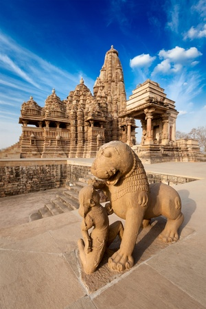 King and lion fight statue and Kandariya Mahadev temple.  Khajuraho, India Stock Photo - 13054976