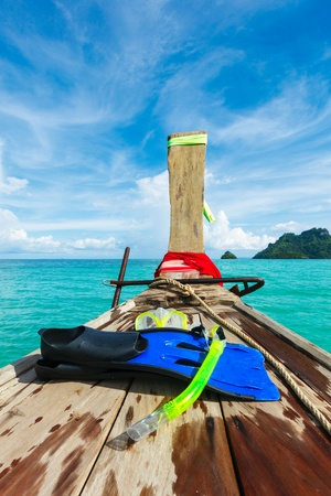 Snorkeling set on boat, sea, island. Thailand photo