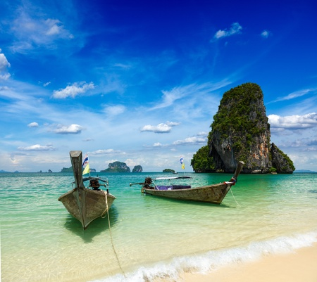 Long tail boats on tropical beach (Pranang beach), Krabi, Thailand photo
