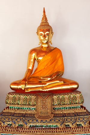 Sitting Buddha Gold Statue close up in Buddhist Temple. Wat Pho, Bangkok, Thailand photo
