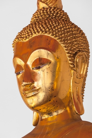 Golden Buddha Statue headclose up in Wat Pho Buddhist Temple, Bangkok, Thailand photo