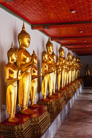 Standing golden Buddha statues. Wat Pho temple, Bangkok, Thailand Stock Photo - 13992966